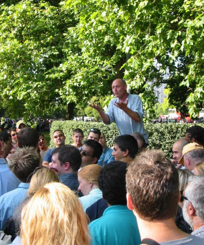 An unknown, to us, man gives a speach at speakers corner in London.